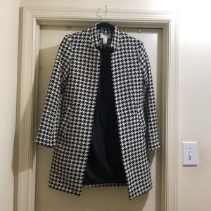 Houndstooth trench jacket.